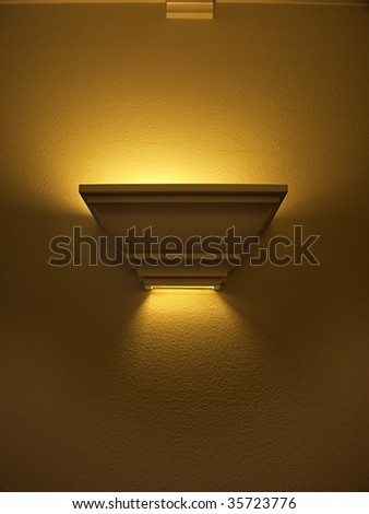 a wooden conch style hallway light illuminated which makes a great design element