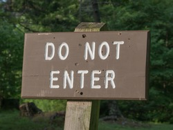 A wooden do not enter sign in a state park, Vermont, USA