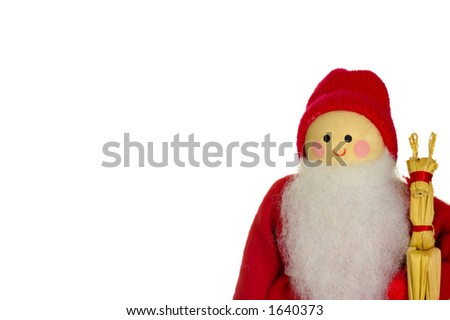 A wooden Father Christmas doll, holding a straw reindeer, isolated on a white background. Space for text.