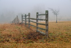 A wooden fence on a foggy winter morning on the Gettysburg National Military Park in Gettysburg, PA, USA.
