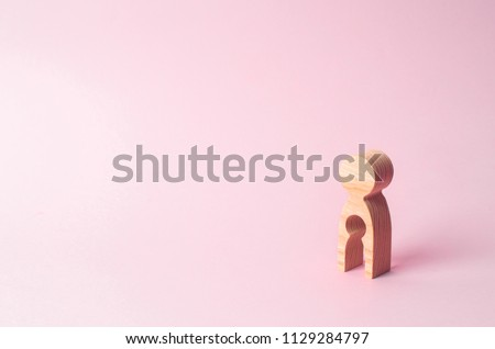 A wooden figure of a woman with a void inside in the shape of a child. The concept of the loss of child, abortion of pregnancy, miscarriage. Infertility in women. unhappy mother lost her child