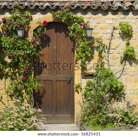 A wooden front door in the ancient stone house