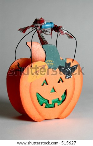 a wooden halloween basket decoration