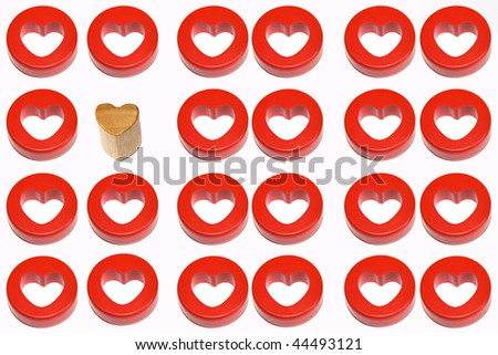 A wooden heart and a red heart next to eleven red heart couples