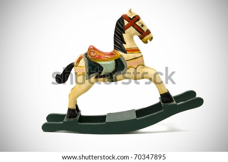 a wooden horse on a vignetting background