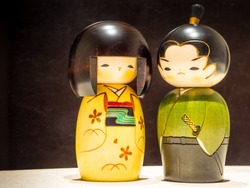 A wooden japanese figures of a Geisha and the Samurai