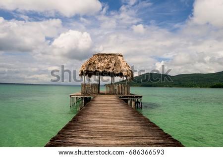 A wooden jetty at Petén Itzá lake. Guatemala #686366593