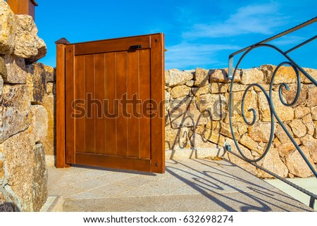 a wooden little gate to luxury...
