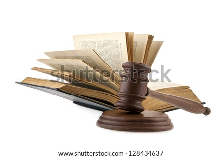 a wooden mallet and a book on a white background