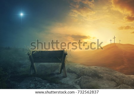 A wooden manger and three wooden crosses