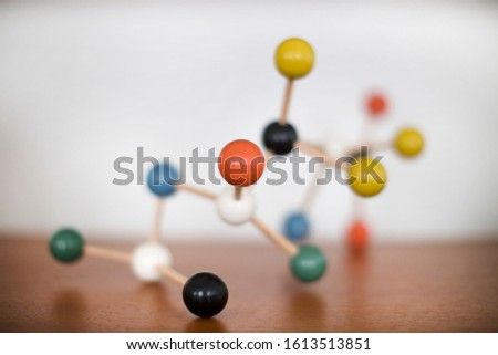 a wooden molecular model display