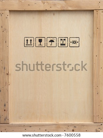 A wooden packing crate with various packing symbols.