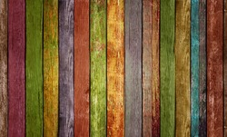 A wooden painted wall consisting of multicolored slats.Texture or background