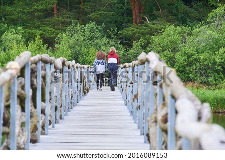 A wooden path around the beautiful pond Olsina. The Olsina pond near Horni Plana is one of the highest altitude ponds in Cezc republic  Stockfoto ©