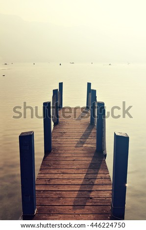 a wooden pier extends into a...