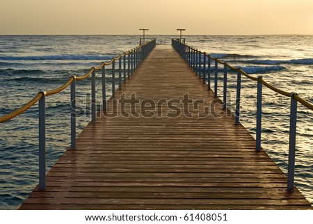 A wooden pier that goes into the sea