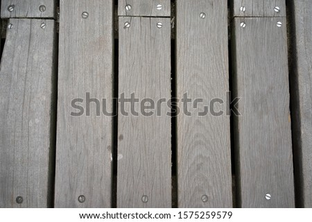 a Wooden planking or landing on a pier, background with structure and pattern use for copy space seen from above