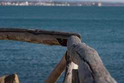 A wooden rail at Santa marinella ,Italy