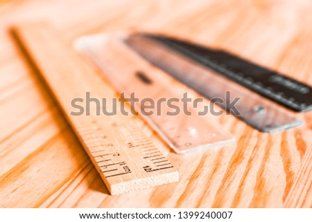 A wooden ruler with measurements for centimeters and inches