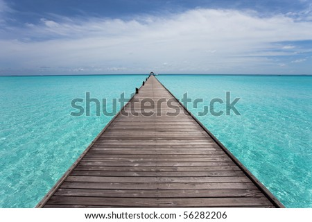 A wooden runway loading over the beautiful turquoise ocean