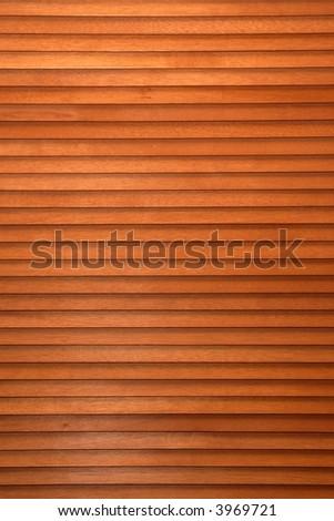 A wooden slatted blind background.