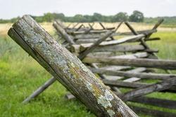 A wooden split-rail fence crosses a meadow in Gettysburg National Military Park in Gettysburg, Pennsylvania.