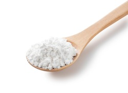 A wooden spoon and potato starch on a white background