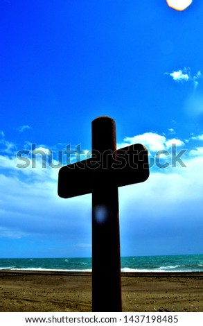 A wooden structure representing a cross. #1437198485
