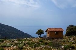 A wooden tiny cabin house at the top of the valley. Mountain House with beautiful sea view.
