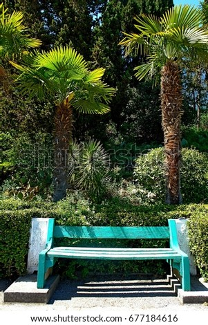 a wooden vintage bench on stone ...
