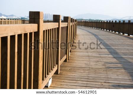 a wooden walkway on seaside.