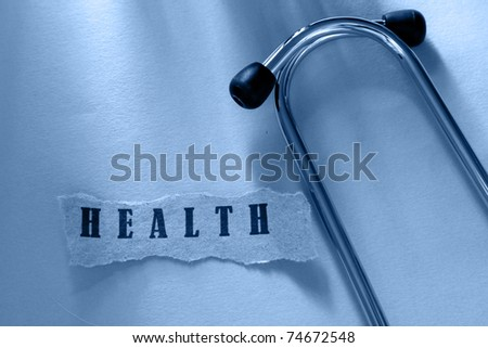 A word health written on a ripped piece of paper and a stethoscope