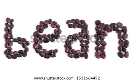 A word lined with dry beans. Broad beans word solate on white background.