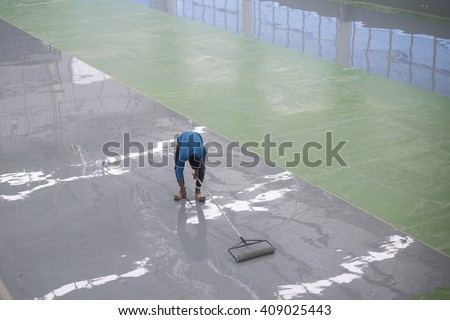 A worker application of epoxy floor