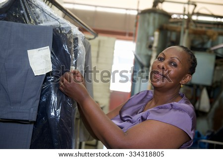 A worker checks cleaning clothes in laundry