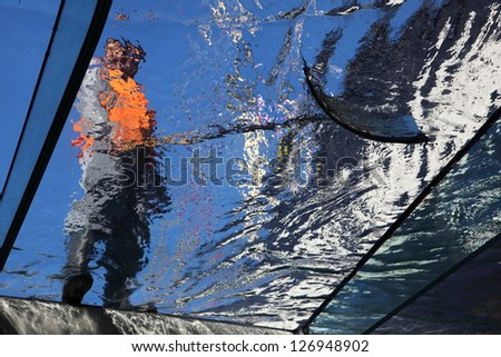 A worker cleaning glass.
