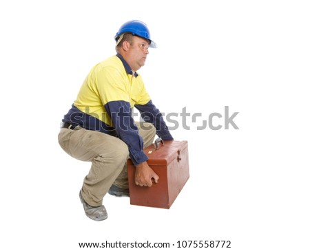 A worker demonstrating a good lifting technique.