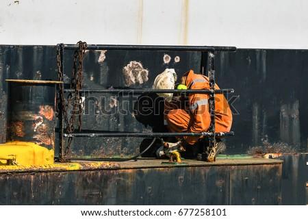 A worker on a ship./ Worker./ A worker on a ship.