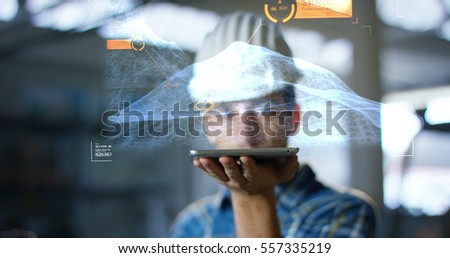 A worker uses a future technology platform to verify the design in holography and augmented virtual reality. Concept: future technology, multimedia technology, futuristic engineering. #557335219