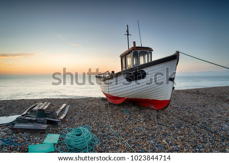 A working fishing boat on the beach at Dungeness on the Kent coast