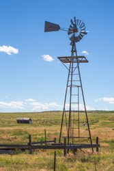 A working windmill and an abandoned prairie shack on the Pawnee National Grasslands in north western Colorado