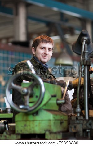 a workman smiling - stock photo