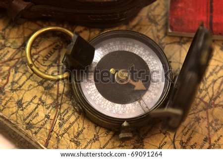 A World War I (WWI) compass sitting on a map.
