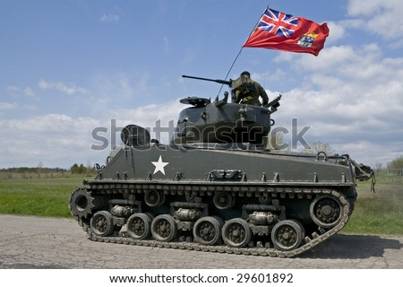 stock photo : A World War Two Mark IV Sherman tank flying the Canadian flag.