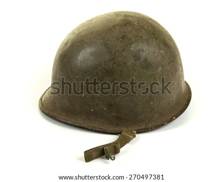 A World War Two period American U.S. Army soldier's steel combat helmet on white background