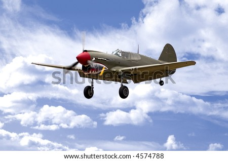 A World War Two U.S. Army Air Corps Curtiss P40 fighter aircraft landing.