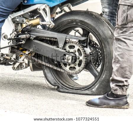 A worn wheel motorbike after drifting Stock fotó ©