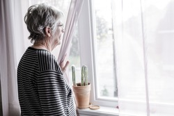 A worried senior woman at home felling very bad