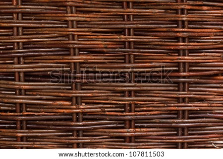a woven willow wicker fence panel suitable for crafts, picnic or gardening background or wallpaper