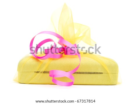 A wrapping gift with pink ribbon